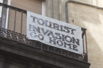 Overtourism-film-still-sign-invasion